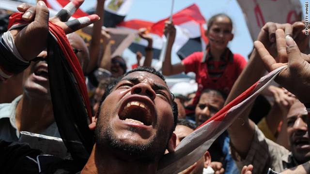 Protesters shout slogans as thousands crowd Cairo's Tahrir Square on July 15, 2011 to demand political change.