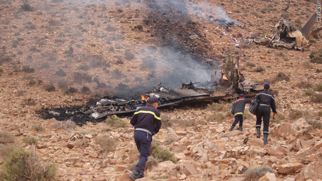 Rescuers arrive at the site where a military transport plane crashed in southern Morocco, with reports of 78 people dead.