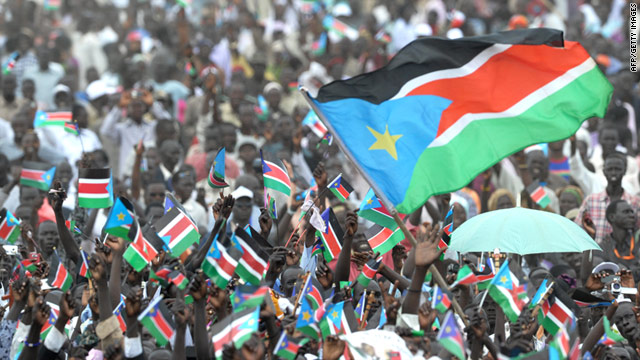 Thousands of Southern Sudanese wave flags during a ceremony in Juba on July 09 to celebate South Sudan's independence