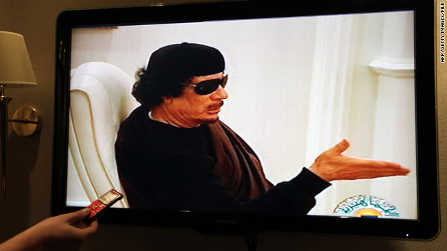In a photo from May, Libyan state TV shows leader Moammar Gadhafi in what it said was a meeting with eastern tribal dignitaries. NATO acknowledged trying to silence Gadhafi's broadcasts.