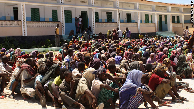 Internally displaced Somali men and women wait for food-aid to be distributed at a centre in Mogadishu, on July 30, 2011