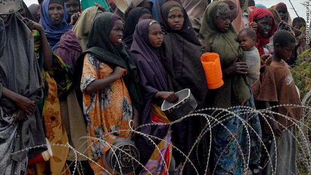 Internally-displaced Somalis wait for food at the Badbaado refugee camp in the Somali capital of Mogadishu on July 26, 2011