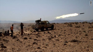A rocket was fired Saturday toward Gadhafi forces outside Bir Al-Ghanam.