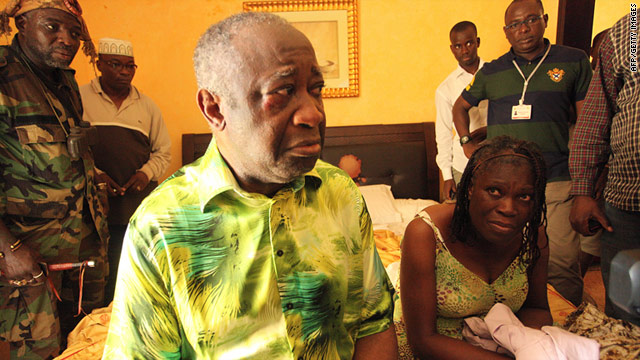 Members of former Ivorian president Laurent Gbagbo, pictured here with his wife Simone after their arrest on April 11, face trial.
