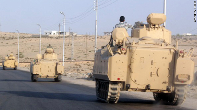 A convoy of Egyptian armoured vehicles head along a road on the Sinai Peninsula near the Gaza border on August 13, 2011