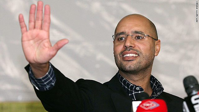 Saif al-Islam Gadhafi, one of three sons of Moammar Gadhafi reportedly captured by Libyan rebels, waves to a crowd in March.