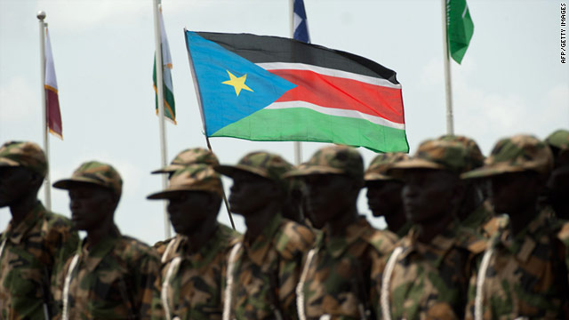 South Sudanese soldiers march with their national flag during a military parade to mark the country's independence in July.