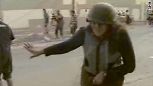 CNN's Sara Sidner ducks while rebels fire celebratory shots into the air in Tripoli, Libya.