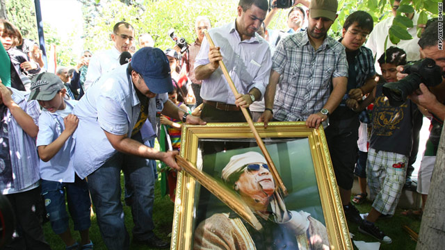 Demonstrators smash a portrait of Moammar Gadhafi during a protest outside the Libyan embassy in Turkey on August 22.