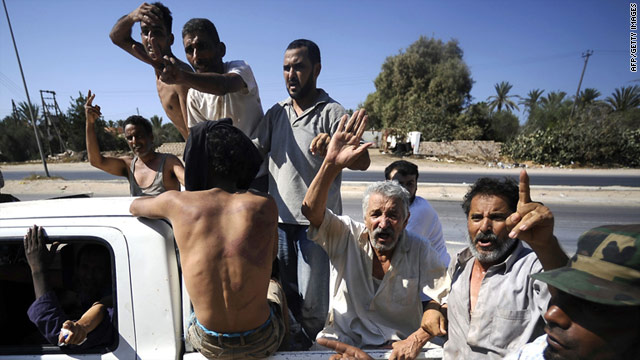 Freed prisoners travel in the back of a pickup truck after being released from a jail by rebel forces in Libya.
