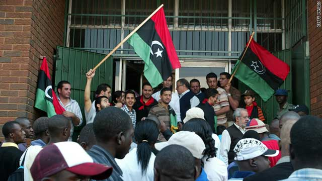 Embassy staff and Libyan nationals demonstrate outside the Libyan embassy in Harare, Zimbabwe, on August 24, 2011.