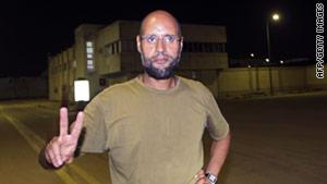 Saif al-Islam Gadhafi said he made Wednesday's phone call from a suburb of Tripoli.