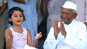 Because of activist Anna Hazare, right, corruption has been brought to the forefront in India.