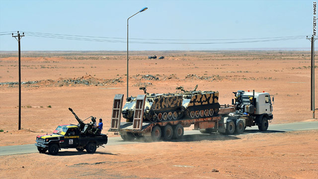 Rebels transport armored vehicles near Bani Wali, Libya, on Wednesday.
