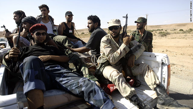 Libyan new regime fighters arrive at a position at outside Bani Walid on September 13.