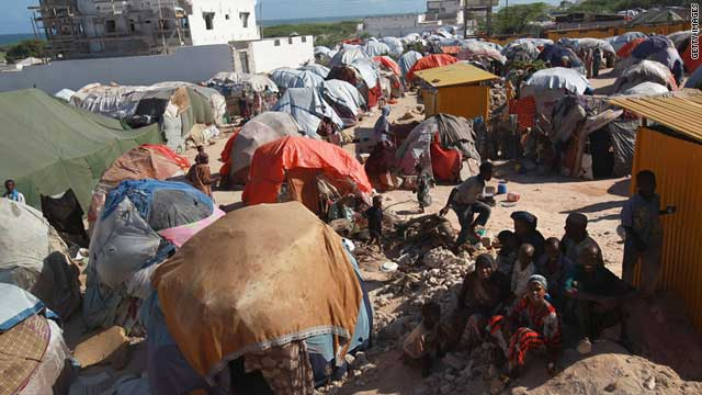 Somalis displaced by famine and drought sit in a makeshift camp on August 16, 2011 in Mogadishu, Somalia.