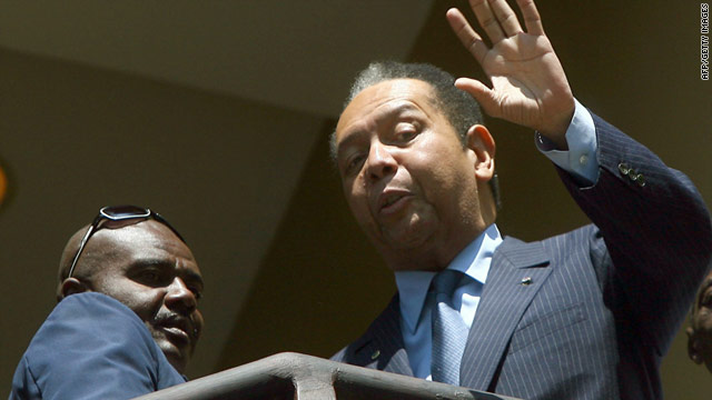 Ex-dictator dictator Jean-Claude Duvalier waves from a balcony at the Hotel Karibe in Port-au-Prince, Haiti, on Wednesday.