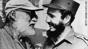 Ernest Hemingway speaks with Cuban leader Fidel Castro in late 1959.