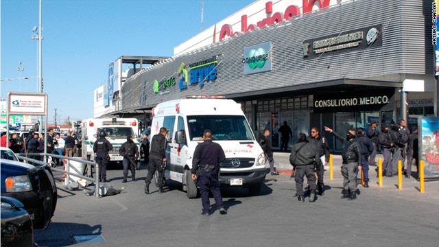Police investigate the scene where a police officer was shot in Ciudad Juarez, Mexico.