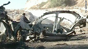 The remains of the vehicle that exploded Saturday sit along an interstate in Hidalgo, Mexico.