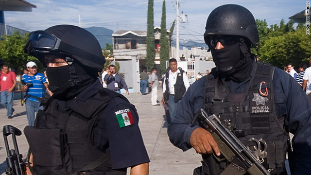 Hector Muruia said Mexican federal police, shown here in July 2010, are to blame for the shooting of his bodyguard on Tuesday.