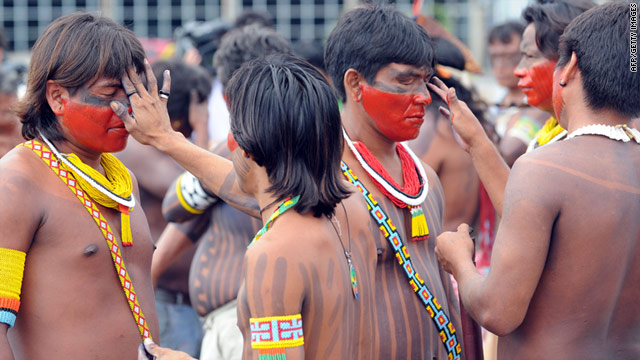 Members of the Caiapo tribe paint themselves during the protest in Brasilia, Brazil.
