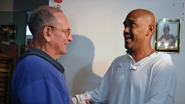Recently freed Cuban dissidents Hector Maseda, left, and Angel Moya greet each other on February 12  in Havana, Cuba.