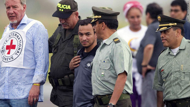 Police officer Carlos Ocampo (center) was the only hostage freed by the FARC rebel group on Sunday.