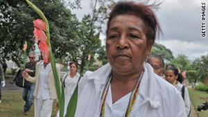 On February 13, Reina Luisa Tamayo marches in honor of her son as part of a group called Ladies in White.