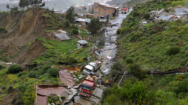 "Locals attempt to recover belongings with trucks following a ""mega-mudslide"" in La Paz on February 27, 2011."