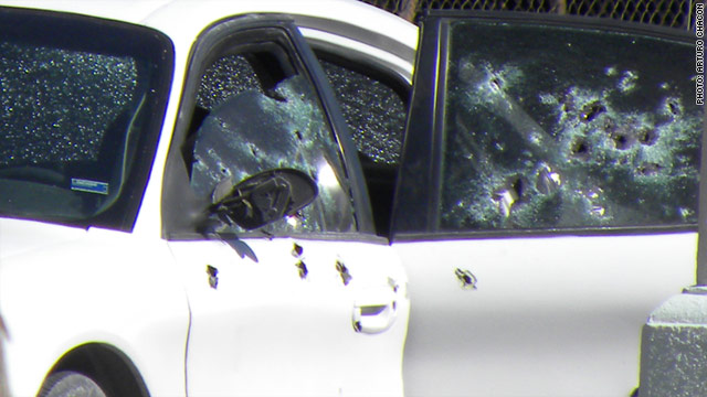 An image from the scene in Ciudad Juarez, Mexico, shows a white sedan the victims occupied when they were attacked.