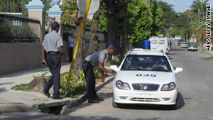Cuban police patrol outside the municipal court in Havana on March 4 during Alan Gross' trial.
