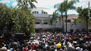 Supporters gather in front of the residence of former Haitian President Jean-Bertrand Aristide on Friday in Port-au-Prince.