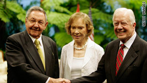 Former president Jimmy Carter (right) shakes hands with Cuban president Raul Castro.