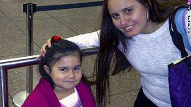 U.S. citizen Emily Ruiz, daughter of Guatemalan immigrants who don't have any documentation, meets her family Wednesday.
