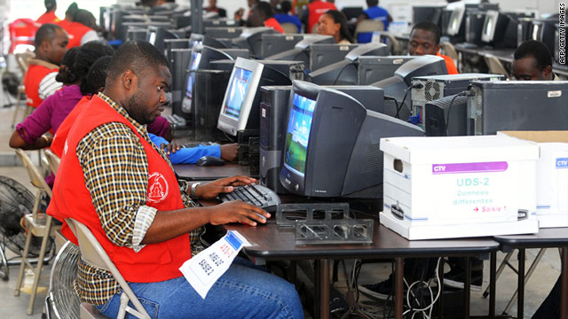 Haitian electoral workers count votes Friday. Final votes for a highly anticipated runoff are not expected until April 16
