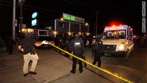 At least 26 bullet casings were found near a Juarez, Mexico, bar where 10 people were shot and killed Thursday.