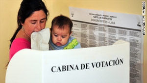 A woman with her toddler votes Sunday in Lima, Peru.