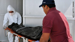 A body is unloaded at the morgue in Mexico. According to authorities, 126 bodies have been recovered