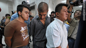Alleged members of the Zetas drug cartel in a Guatemala court on May 26 charged with the murder of 27 peasants.