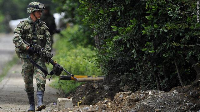 A Colombian soldier patrols along a road during fighting with alleged FARC members, on April 08, 2011, in El Palo, Colombia.