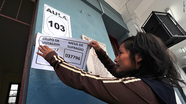 A Peruvian National Office of Electoral Processes (ONPE) employee prepares electoral material at a polling station in Lima on June 4, 2011.