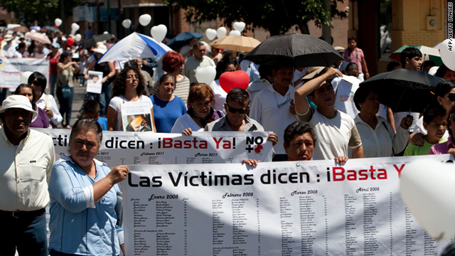"Demonstrators hold a banner reading ""Victims say: Stop now!"" in Ciudad Juarez, on May 7, 2011, to protest drug violence."
