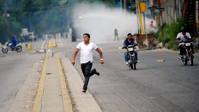 The Venezuelan National Guard charges relatives rioting outside of El Rodeo I prison on Friday.
