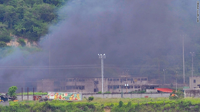 Smoke billows from the Rodeo I prison near Caracas, Venezuela, on June 17.