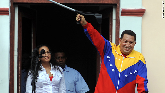 President Hugo Chavez, right, raises a crutch after his weekly program 'Alo Presidente', in Caracas, on May 22, 2011.
