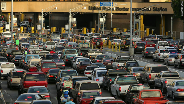 Cars wait in typically long lines to enter the United States from Mexico in Tijuana, Mexico.