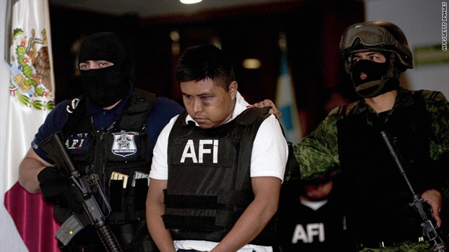 Alleged member of Los Zetas drug cartel Abraham Barrios Caporal, aka 'El Erasmo', is presented to the press in Mexico City, on June 30.