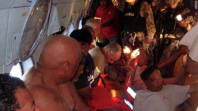 Survivors from the capsizing of the Erik fishing boat fly on a helicopter to safety. Seven Americans are still missing.