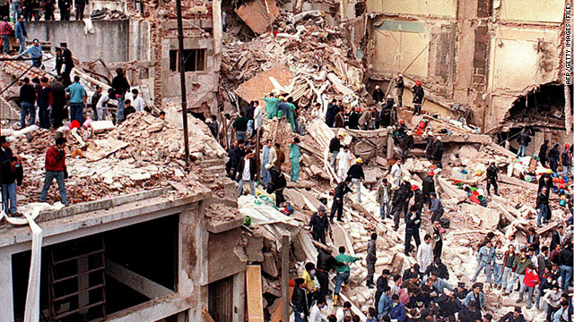 Rescue workers search the remains of the AMIA headquarters in Buenos Aires, Argentina, in 1994.